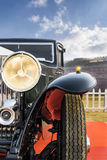 Front low angle view of a Classic Retro Old-timer Vintage Saloon. Front low angle view of an Oldtimer Vintage Saloon Car. The front lights and chrome grill of Stock Image