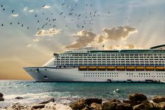 Front of Luxury Cruise Ship Moored Beyond Rocks Stock Photos