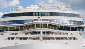 Front of Massive White Luxury Cruise Ship. The Front of Massive White Luxury Cruise Ship with bridge Stock Photo