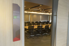 Front of meeting room with tag status vacant and Fire alarm notification wooden table sunlight from window.  Stock Images