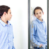 In front of mirror. Boy posing in front of mirror Royalty Free Stock Image