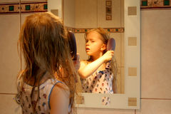 In front of the mirror Royalty Free Stock Photography