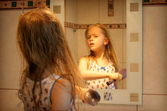 In front of the mirror Royalty Free Stock Images