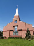 Front of a modern red brick church Stock Photo