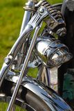 Front of a motorcycle showing chrome fender and light Stock Photo