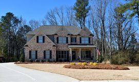 New home, Watkinsville, Georgia with driveway. Front of new home on long driveway in Watkinsville, Georgia against blue skies on sunny day Stock Image