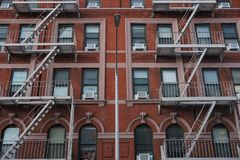 New York City building with fire escapes and a lampost stock photos