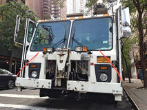 Front of a NYC sanitation truck. NYC sanitation truck parked in the street Royalty Free Stock Image