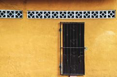 Old yellow house facade, Nicaragua. Front Of A Old Antique Traditional House With Vibrant Yellow Facade royalty free stock photos