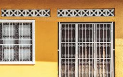 Old yellow house facade, Nicaragua. Front Of A Old Antique Traditional House With Vibrant Yellow Facade stock photos