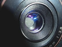 The front of an old camera lens royalty free stock photos