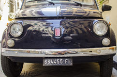 Front of an old car. Old fiat in florence, front old car Royalty Free Stock Photography