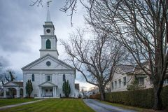 Front of the old church. Old american church with lawn and road Royalty Free Stock Photo