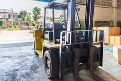 Front of old forklift vehicle used in industrial warehouse Royalty Free Stock Photo