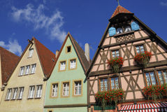 Front of old German buildings. A view of the front of several quaint German buildings in Rothenburg ob de Tauber on a bright, sunny day royalty free stock photo