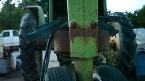 Front of old, green, rusty tractor. stock video
