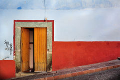Front of an old house, blue and red walls. Picture of a house in a village, Mexico Stock Image