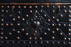 Front of an old iron chest with a beautiful forged ornament and stock photography