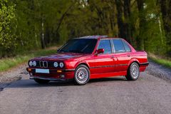 The front of the old, red, German car that stands in the forest.  royalty free stock photography