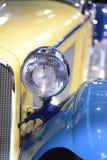 Old car, retro, closeup. Front of old yellow car, closeup Royalty Free Stock Images