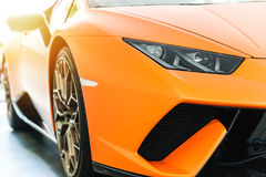 Front of an orange sport luxury car in sunset Stock Images