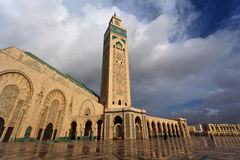 Front of ornate Hassan II Mosque archways minaret. Stock Image