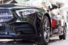 Front part of a black car. Front part of a new black luxury car on the street royalty free stock photography