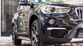 Front part of a black car. Front part of a new black luxury car on the street stock photo