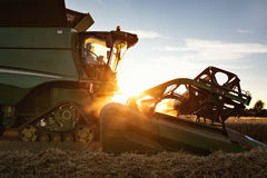 Front part of a combine at sunset Stock Image