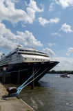 Front part of cruise liner moored in the seaport. Closeup. on su Royalty Free Stock Photos