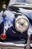 Front part with headlight of British retro car headlight.  stock image