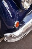 Front part with headlight and chrome bumper of British retro car.  stock image