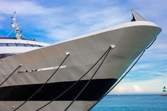 Front part of large luxury yacht tied to the dock on Lake Michigan.  stock photo