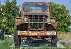 Old devastated truck. Front part of an old-fashioned rotting truck in the yard royalty free stock images