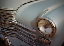 Front part of an old 60s car. The front part of an old 60s car royalty free stock image