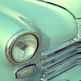 Front part of an old 60s car. The front part of an old 60s car stock photos