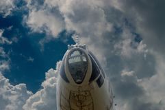 The front part of the plane against a backdrop of blue sky in the clouds. The front part of the plane against backdrop of blue sky in the clouds royalty free stock photo