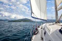 Front part of a sailboat, set on full sails to the sea Royalty Free Stock Photo