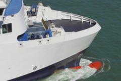 Front part of sea vessel on run. Warnemunde, Rostock, Germany stock photos