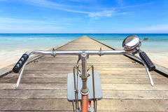 Front part of vintage bicycle. View from bikers eyes on wood bri Stock Images