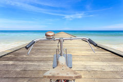 Front part of vintage bicycle. View from bikers eyes on wood bri Stock Photo