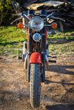 Front part of a vintage motorcycle, red bike stock photography