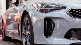 Front part of a white modern car. Front part of a new white modern car. Luxury cars exhibition royalty free stock photography