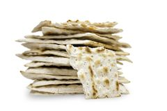 A front photo of many pieces of matzah or matza isolated on white background. Matzah for the Jewish Passover holidays. Place for t. Ext, copy space. Selective Royalty Free Stock Photo