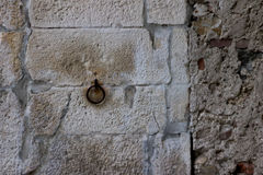 Front photo of an old wall with rusty ring Stock Photo