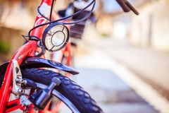 Bike in the city: Front picture of a city bike, blurred background. Front picture of a city bike, head lamp and blurry background bicycle mobility urban tour royalty free stock images
