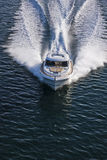 Front picture of a sailing speed boat. Front picture of a white speed boat sailing on a bright and sunny day Stock Image