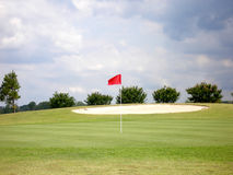 Front pin. Golf green on stormy summer day Stock Images