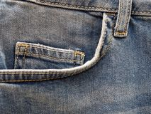 Front pocket of blue jeans, close up royalty free stock photography