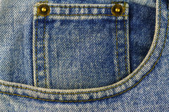 Front pocket of blue jeans, denim texture background Royalty Free Stock Image